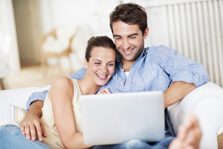 young-couple-on-computer-home-horiz_jisgcm